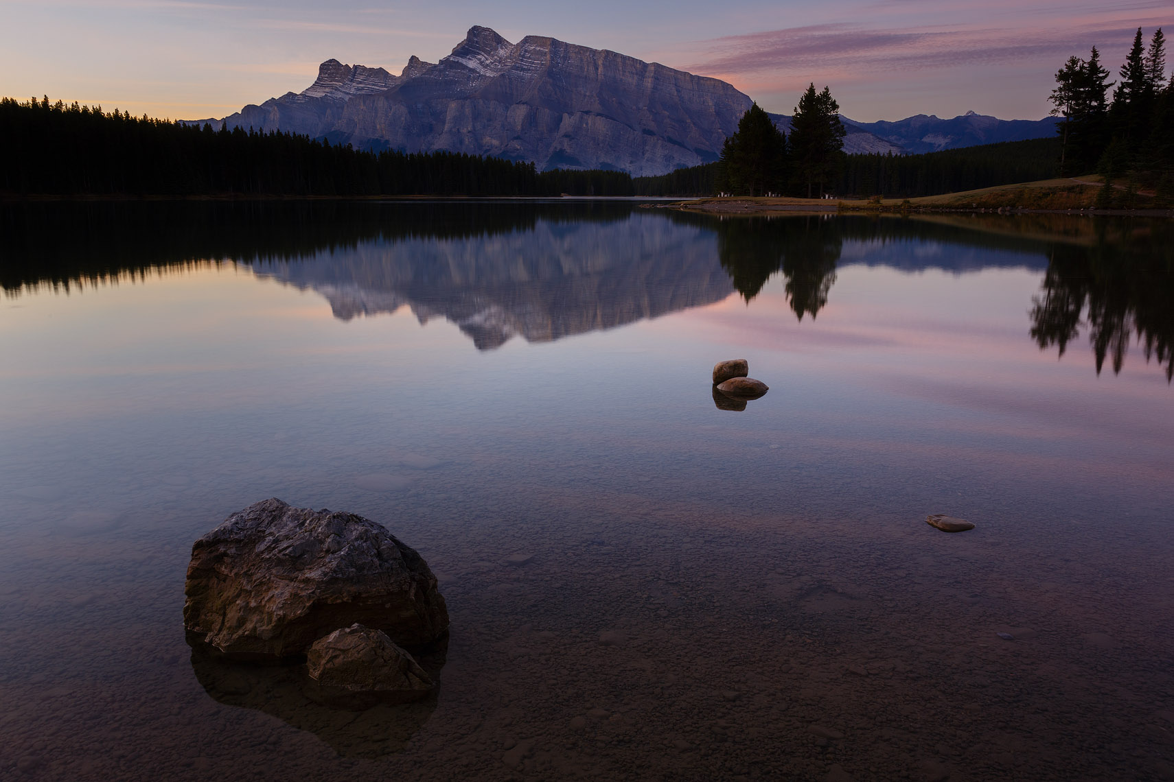 Two Jack Lake sunrise with rock